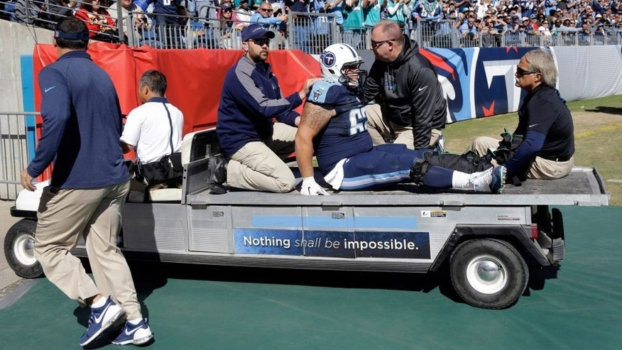 Tennessee Titans center Brian Schwenke (62) is taken off the field after injuring his leg in the first half of an NFL football game against the Miami Dolphins Sunday, Oct. 18, 2015, in Nashville, Tenn. (AP Photo/James Kenney)