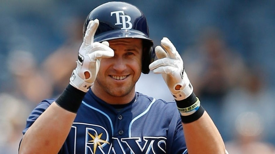 Tampa Bay Rays designated hitter Evan Longoria gestures toward the dugout after hitting a first-inning double in a baseball game against the New York Yankees at Yankee Stadium in New York, Sunday, July 5, 2015. (AP Photo/Kathy Willens)