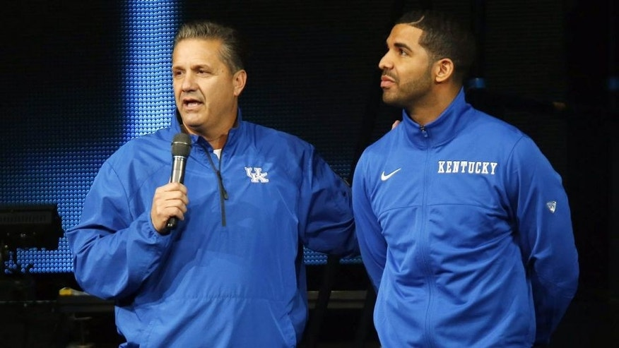 CORRECTS DAY OF WEEK TO FRIDAY - Kentucky coach John Calipari, left, and hip-hop star Drake speak during the team's NCAA college basketball Big Blue Madness, Friday, Oct. 17, 2014, in Lexington, Ky. (AP Photo/James Crisp)