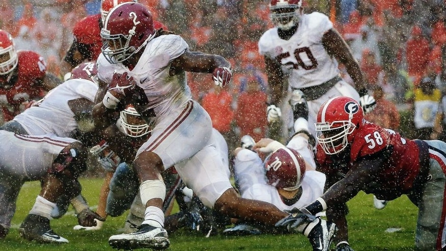 ATHENS, GA - OCTOBER 03: Derrick Henry #2 of the Alabama Crimson Tide breaks a tackle by Sterling Bailey #58 of the Georgia Bulldogs at Sanford Stadium on October 3, 2015 in Athens, Georgia. (Photo by Kevin C. Cox/Getty Images)