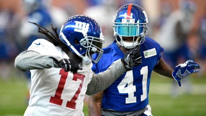 Jun 16, 2015; East Rutherford, NJ, USA; New York Giants cornerback Dominique Rodgers-Cromartie (41) defends wide receiver Dwayne Harris (17) during minicamp at Quest Diagnostics Training Center. Mandatory Credit: Steven Ryan-USA TODAY Sports