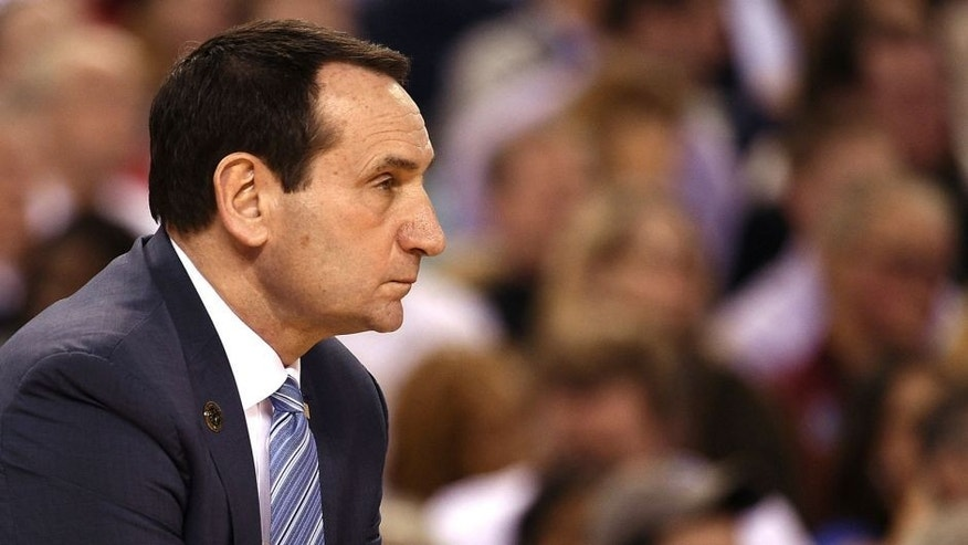 INDIANAPOLIS, IN - APRIL 04: Head Coach Mike Krzyzewski of the Duke Blue Devils looks on against the Michigan State Spartans during the NCAA Men's Final Four Semifinal at Lucas Oil Stadium on April 4, 2015 in Indianapolis, Indiana. Duke won 81-61. (Photo by Lance King/Getty Images)
