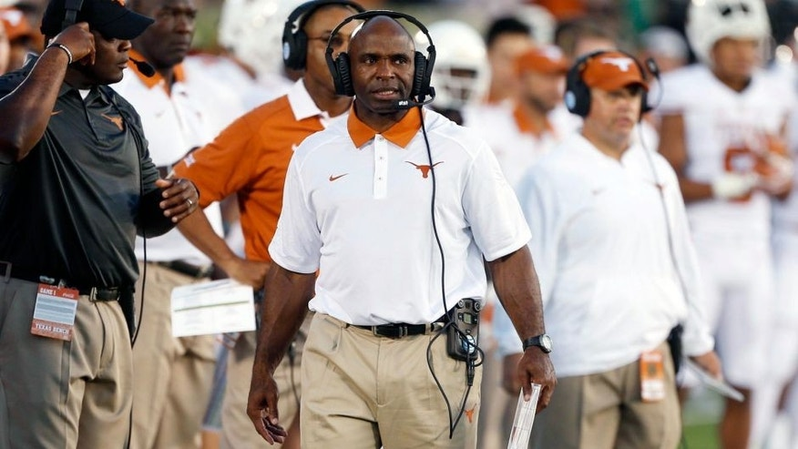 Sep 5, 2015; South Bend, IN, USA; Texas Longhorns coach Charlie Strong coaches on the sidelines against the Notre Dame Fighting Irish at Notre Dame Stadium. Mandatory Credit: Brian Spurlock-USA TODAY Sports