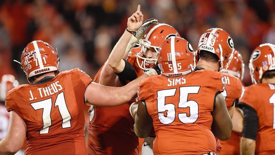 Oct 17, 2015; Athens, GA, USA; Georgia Bulldogs place kicker Marshall Morgan (finger raised) and team mates react after he kicked the go ahead field goal against the Missouri Tigers during the second half at Sanford Stadium. Georgia defeated Missouri 9-6. Mandatory Credit: Dale Zanine-USA TODAY Sports