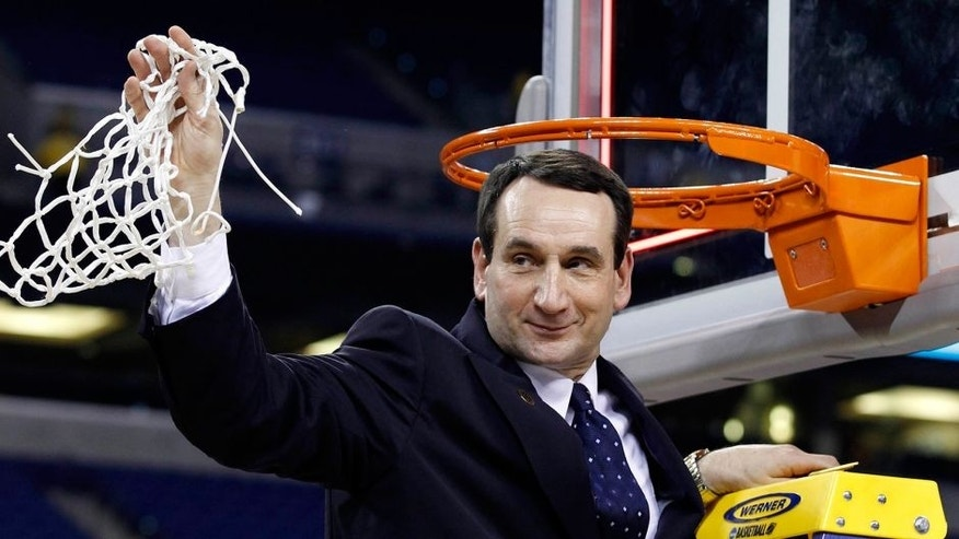 Apr 5, 2010; Indianapolis, IN, USA; Duke Blue Devils head coach Mike Krzyzewski waves to the crowd after cutting down a piece of the net after defeating the Butler Bulldogs 61-59 in the national championship game of the Final Four of the 2010 NCAA mens basketball tournament at Lucas Oil Stadium. Mandatory Credit: Bob Donnan-USA TODAY Sports