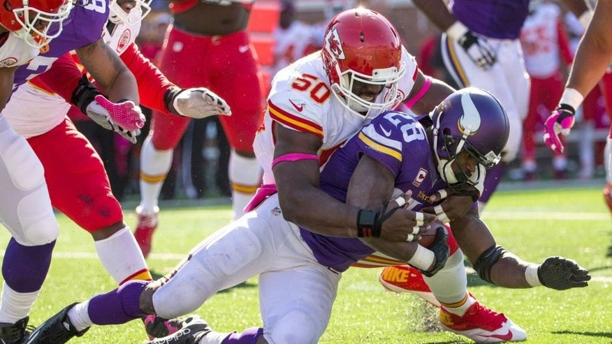 Oct 18, 2015; Minneapolis, MN, USA; Minnesota Vikings running back Adrian Peterson (28) is tackled by Kansas City Chiefs linebacker Justin Houston (50) during the third quarter at TCF Bank Stadium. The Vikings defeated the Chiefs 16-10. Mandatory Credit: Brace Hemmelgarn-USA TODAY Sports