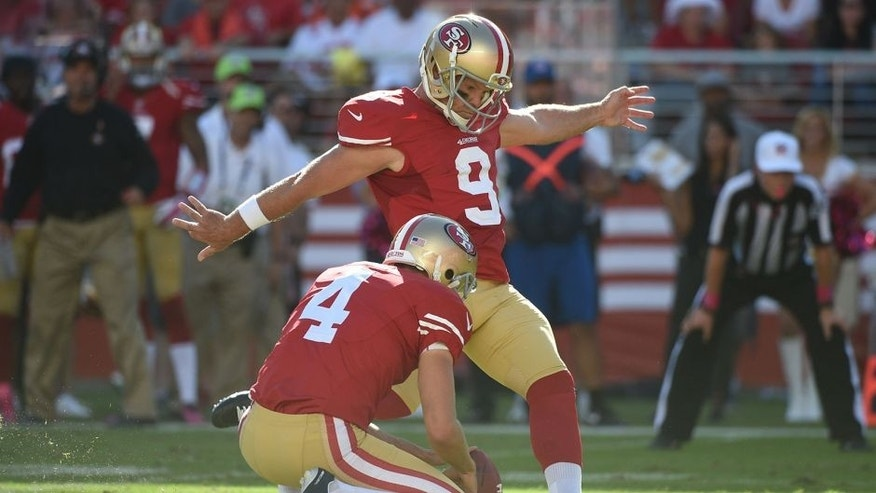 October 5, 2014; Santa Clara, CA, USA; San Francisco 49ers kicker Phil Dawson (9) kicks the field goal out of the hold by punter Andy Lee (4) during the fourth quarter against the Kansas City Chiefs at Levi's Stadium. The 49ers defeated the Chiefs 22-17. Mandatory Credit: Kyle Terada-USA TODAY Sports