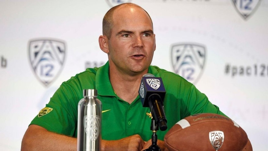 Jul 23, 2014; Hollywood, CA, USA; Oregon Ducks head coach Mark Helfrich talks to the media during the Pac-12 Media Day at the Studios at Paramount. Mandatory Credit: Kelvin Kuo-USA TODAY Sports