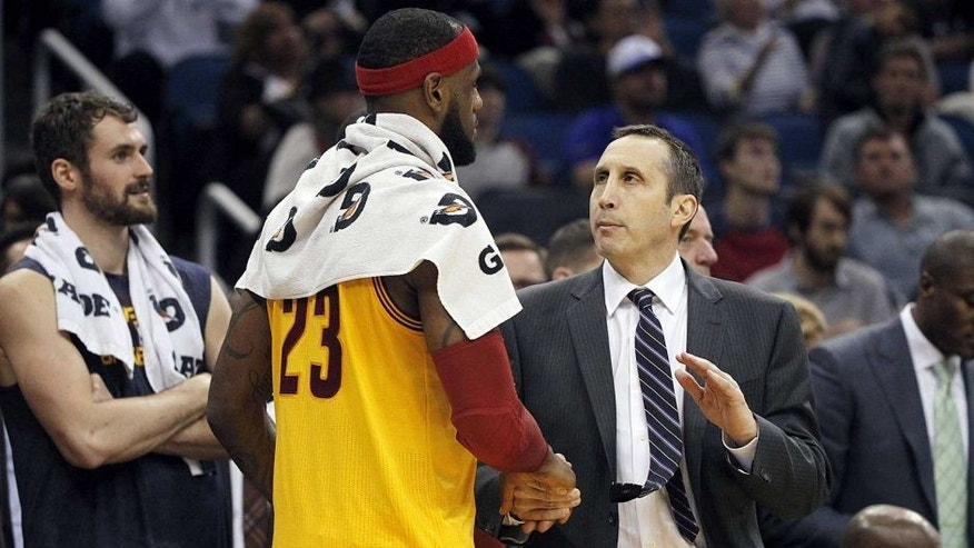 Dec 26, 2014; Orlando, FL, USA; Cleveland Cavaliers head coach David Blatt congratulates forward LeBron James (23) at the end of the game against the Orlando Magic at Amway Center. Cleveland Cavaliers defeated the Orlando Magic 98-89. Mandatory Credit: Kim Klement-USA TODAY Sports