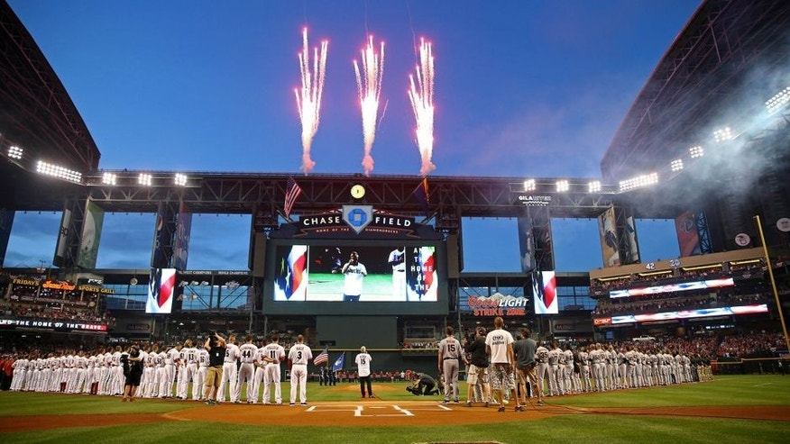 Apr 6, 2015; Phoenix, AZ, USA; Overall view of Chase Field as a fireworks explode as recording artist Taylor Hicks sings the national anthem prior to the Arizona Diamondbacks game against the San Francisco Giants during opening day. Mandatory Credit: Mark J. Rebilas-USA TODAY Sports