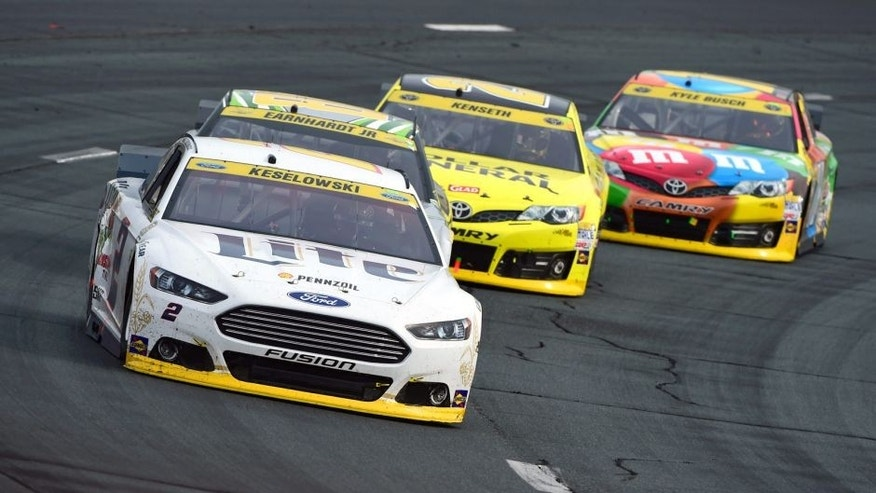 LOUDON, NH - SEPTEMBER 21: Brad Keselowski, driver of the #2 Miller Lite Ford, leads Dale Earnhardt Jr., driver of the #88 Diet Mountain Dew Chevrolet, Matt Kenseth, driver of the #20 Dollar General Toyota, and Kyle Busch, driver of the #18 M&M's Toyota, during the NASCAR Sprint Cup Series Sylvania 300 at New Hampshire Motor Speedway on September 21, 2014 in Loudon, New Hampshire. (Photo by Robert Laberge/NASCAR via Getty Images)