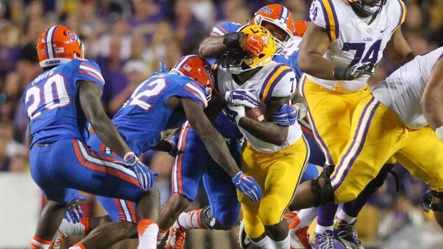 Oct 17, 2015; Baton Rouge, LA, USA; LSU Tigers running back Leonard Fournette (7) is tackled by Florida Gators linebacker Antonio Morrison (3) at Tiger Stadium. Mandatory Credit: Crystal LoGiudice-USA TODAY Sports