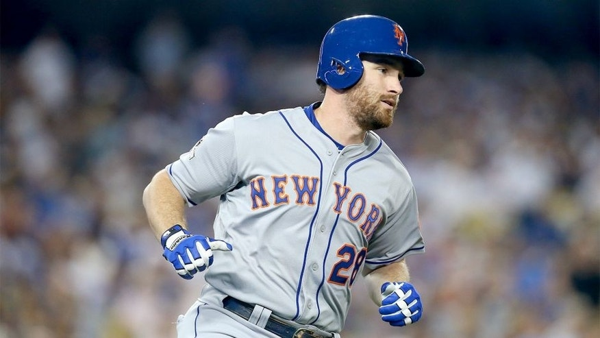 LOS ANGELES, CA - OCTOBER 09: Daniel Murphy #28 of the New York Mets rounds the bases after hitting a solo home run in the fourth inning against the Los Angeles Dodgers in game one of the National League Division Series at Dodger Stadium on October 9, 2015 in Los Angeles, California. (Photo by Stephen Dunn/Getty Images)