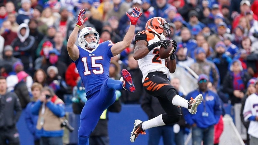 Oct 18, 2015; Orchard Park, NY, USA; Cincinnati Bengals cornerback Darqueze Dennard (21) intercepts a pass intended for Buffalo Bills wide receiver Chris Hogan (15) during the first half at Ralph Wilson Stadium. Mandatory Credit: Kevin Hoffman-USA TODAY Sports
