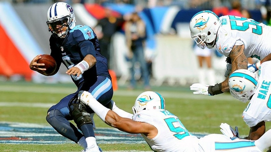 Oct 18, 2015; Nashville, TN, USA; Tennessee Titans quarterback Marcus Mariota (8) is sacked by Miami Dolphins defensive end Olivier Vernon (50) during the first half at Nissan Stadium. Mandatory Credit: Christopher Hanewinckel-USA TODAY Sports