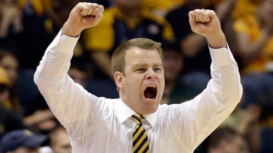Marquette head coach Steve Wojciechowski shouts during the second half of an NCAA college basketball game against Morgan State Sunday, Dec. 28, 2014, in Milwaukee. (AP Photo/Aaron Gash)