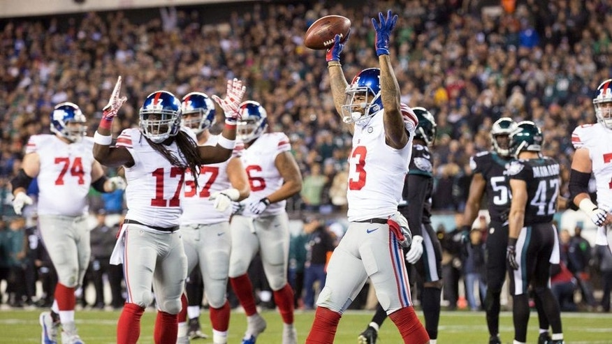 Oct 19, 2015; Philadelphia, PA, USA; New York Giants wide receiver Odell Beckham (13) reacts after scoring a touchdown against the Philadelphia Eagles during the first quarter at Lincoln Financial Field. Mandatory Credit: Bill Streicher-USA TODAY Sports
