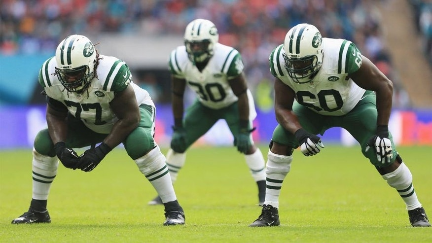 LONDON, ENGLAND - OCTOBER 04: James Carpenter #77 of the New York Jets, Darrin Walls #30 of the New York Jets and D'Brickashaw Ferguson #60 of the New York Jets wait at the line of scrimmage during the game against Miami Dolphins at Wembley Stadium on October 4, 2015 in London, England. (Photo by Stephen Pond/Getty Images)