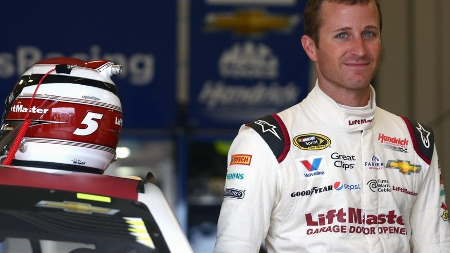 SPARTA, KY - JULY 10: Kasey Kahne, driver of the #5 LiftMaster Chevrolet, looks on in the garage area during practice for the NASCAR Sprint Cup Series Quaker State 400 Presented by Advance Auto Parts at Kentucky Speedway on July 10, 2015 in Sparta, Kentucky. (Photo by Sarah Crabill/Getty Images)