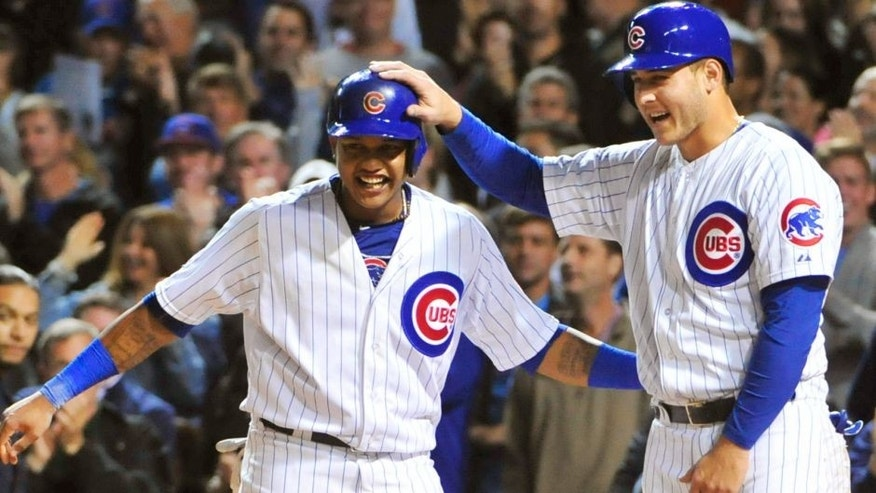 Starlin Castro (L) of the Chicago Cubs and Anthony Rizzo (R) celebrate a Jorge Soler #68 three-run home run against the Milwaukee Brewers during the seventh inning on September 21, 2015 at Wrigley Field in Chicago, Illinois. (Photo by David Banks/Getty Images)