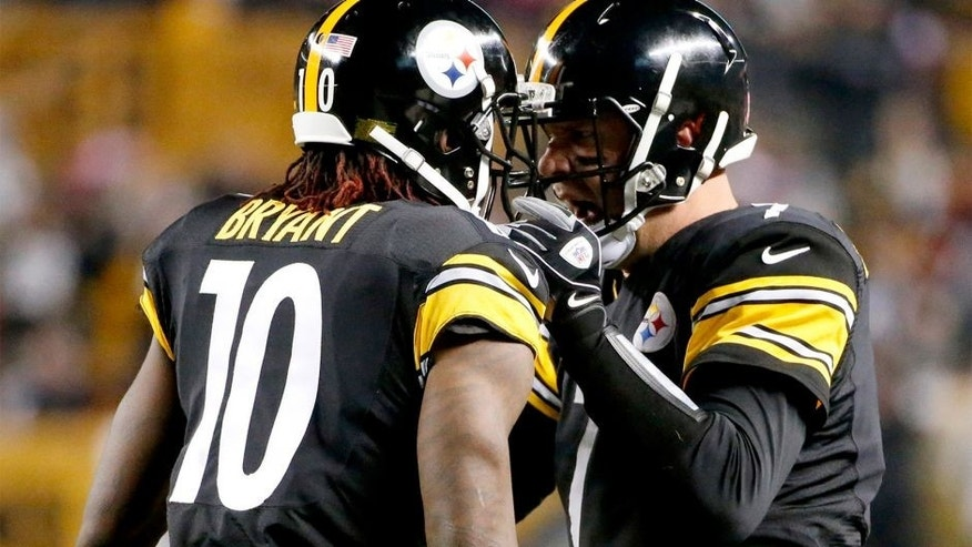 Pittsburgh Steelers wide receiver Martavis Bryant (10) is greeted by quarterback Ben Roethlisberger (7) after making a touchdown catch from Roethlisberger in the second quarter of the NFL football game, Monday, Oct. 20, 2014, in Pittsburgh. (AP Photo/Gene J. Puskar)