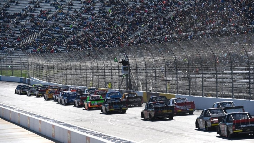 Drivers race during the NASCAR Camping World Truck Series Kroger 250 at Martinsville Speedway on March 28, 2015 in Martinsville, Virginia.