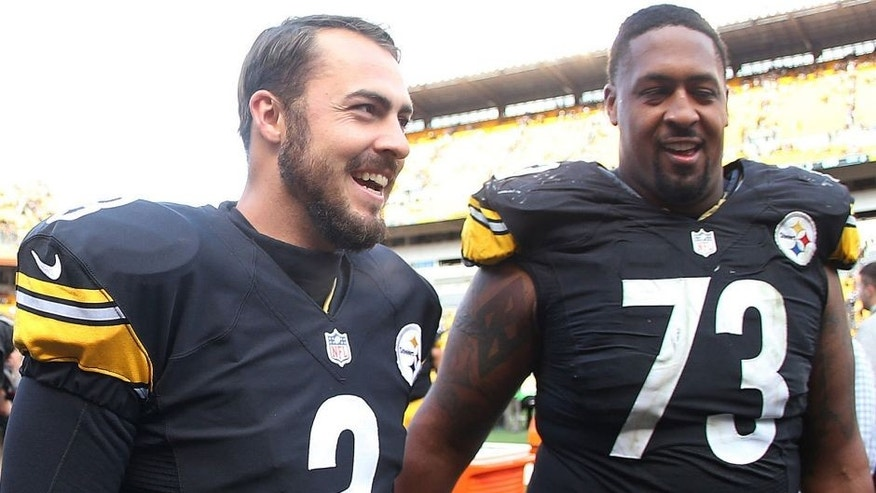Oct 18, 2015; Pittsburgh, PA, USA; Pittsburgh Steelers quarterback Landry Jones (3) and guard Ramon Foster (73) react as they exit the field after defeating the Arizona Cardinals at Heinz Field. The Steelers won 25-13. Mandatory Credit: Charles LeClaire-USA TODAY Sports