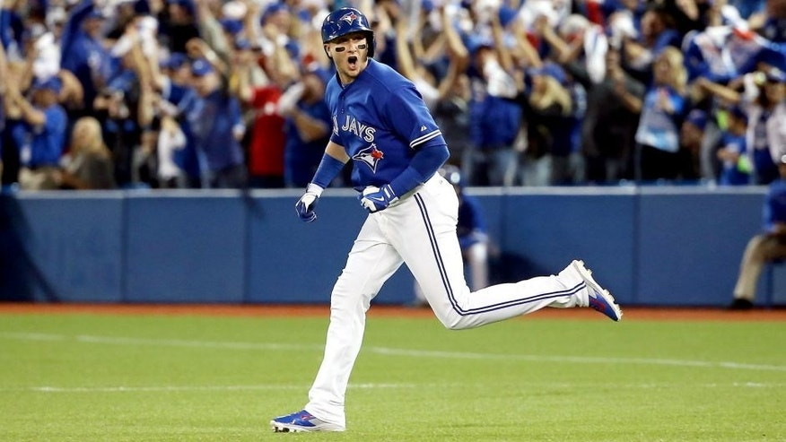 TORONTO, ON - OCTOBER 19: Troy Tulowitzki #2 of the Toronto Blue Jays runs the bases after hitting a three-run home run in the third inning against the Kansas City Royals during game three of the American League Championship Series at Rogers Centre on October 19, 2015 in Toronto, Canada. (Photo by Tom Szczerbowski/Getty Images)