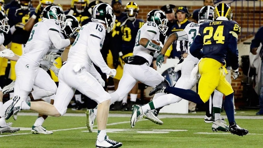 Michigan State defensive back Jalen Watts-Jackson (20) runs towards the end zone after recovering a fumbled snap on a punt in the closing seconds of the second half of an NCAA college football game, Saturday, Oct. 17, 2015, in Ann Arbor, Mich. Watts-Jackson lumbered 38 yards for a touchdown on the final play of the game, giving No. 7 Michigan State a shocking 27-23 win over No. 12 Michigan(AP Photo/Carlos Osorio)