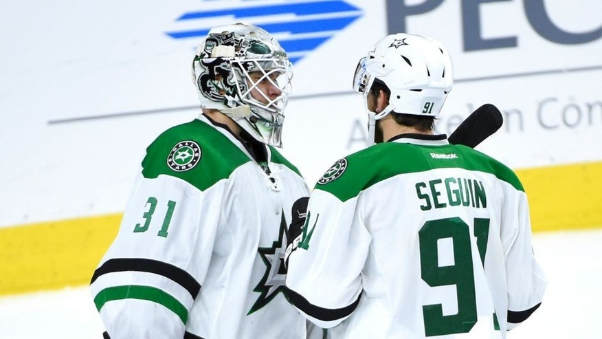 Oct 20, 2015; Philadelphia, PA, USA; Dallas Stars goalie Antti Niemi (31) and center Tyler Seguin (91) celebrate the win against the Philadelphia Flyers at Wells Fargo Center. The Stars defeated the Flyers, 2-1. Mandatory Credit: Eric Hartline-USA TODAY Sports