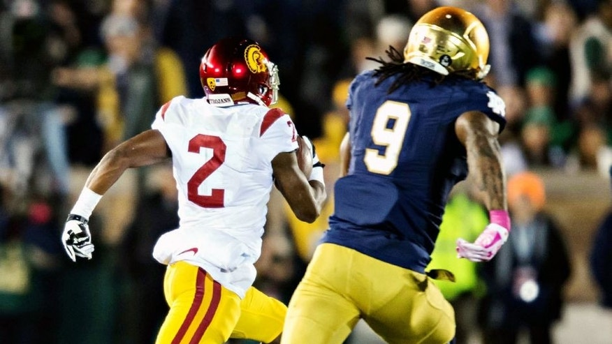 Oct 17, 2015; South Bend, IN, USA; USC Trojans wide receiver Adoree Jackson (2) runs for a touchdown as Notre Dame Fighting Irish linebacker Jaylon Smith (9) pursues in the second quarter at Notre Dame Stadium. Mandatory Credit: Matt Cashore-USA TODAY Sports