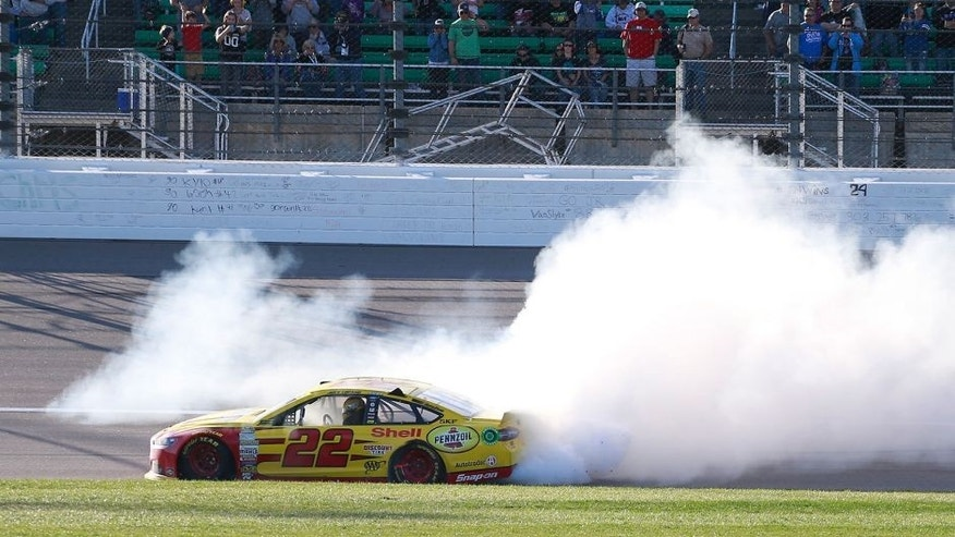 KANSAS CITY, KS - OCTOBER 18: Joey Logano, driver of the #22 Shell Pennzoil Ford, celebrates with a burnout after winning the NASCAR Sprint Cup Series Hollywood Casino 400 at Kansas Speedway on October 18, 2015 in Kansas City, Kansas. (Photo by Matt Sullivan/Getty Images)