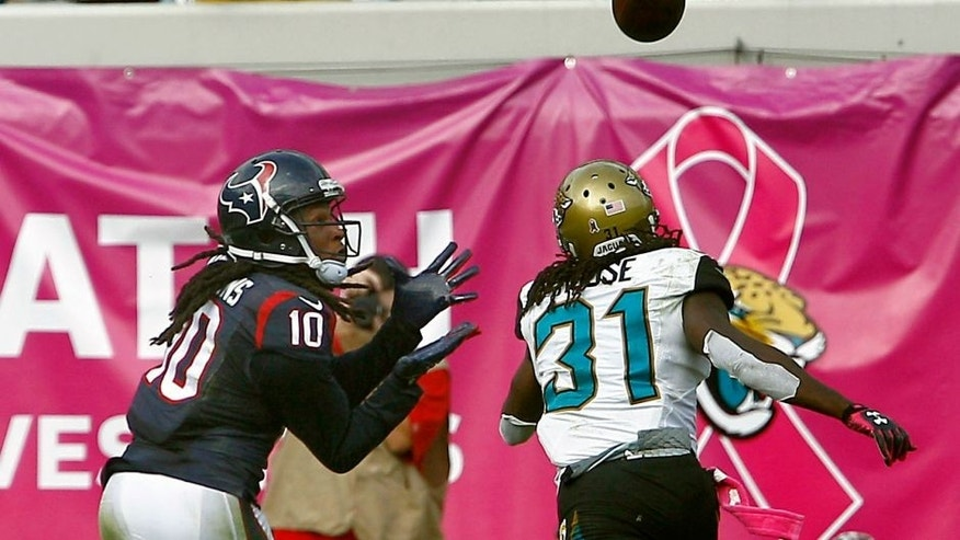 Oct 18, 2015; Jacksonville, FL, USA; Houston Texans wide receiver DeAndre Hopkins (10) makes a touchdown catch over Jacksonville Jaguars cornerback Davon House (31) during the second half of a football game at EverBank Field. Houston won 31-20. Mandatory Credit: Reinhold Matay-USA TODAY Sports