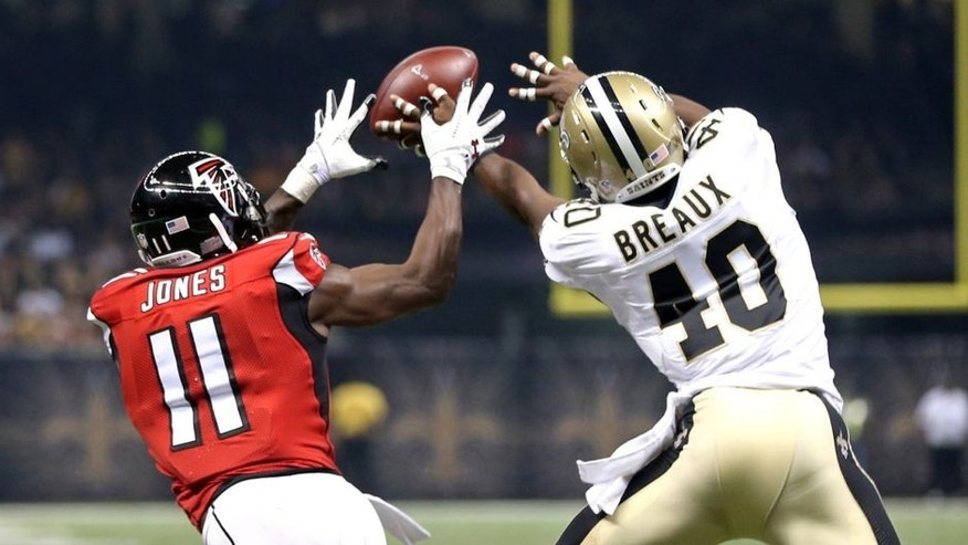 Oct 15, 2015; New Orleans, LA, USA; New Orleans Saints cornerback Delvin Breaux (40) breaks up a pass intended for Atlanta Falcons wide receiver Julio Jones (11) in the second quarter of their game at the Mercedes-Benz Superdome. Mandatory Credit: Chuck Cook-USA TODAY Sports