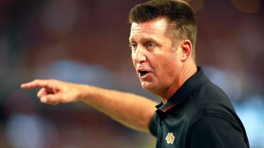 Aug 30, 2014; Arlington, TX, USA; Oklahoma State Cowboys head coach Mike Gundy points during the fourth quarter against the Florida State Seminoles at AT&T Stadium. The Seminoles beat the Cowboys 37-31. Mandatory Credit: Tim Heitman-USA TODAY Sports