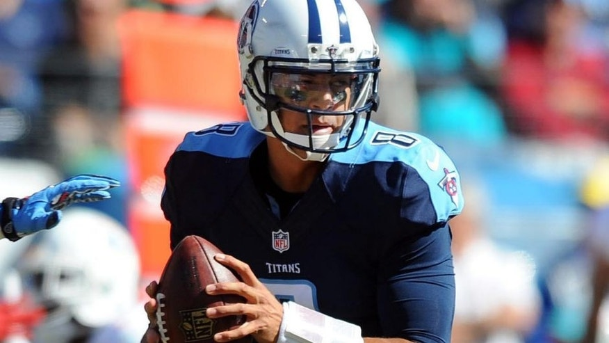 Oct 18, 2015; Nashville, TN, USA; Tennessee Titans quarterback Marcus Mariota (8) drops back to pass during the first half against the Miami Dolphins at Nissan Stadium. Mandatory Credit: Christopher Hanewinckel-USA TODAY Sports