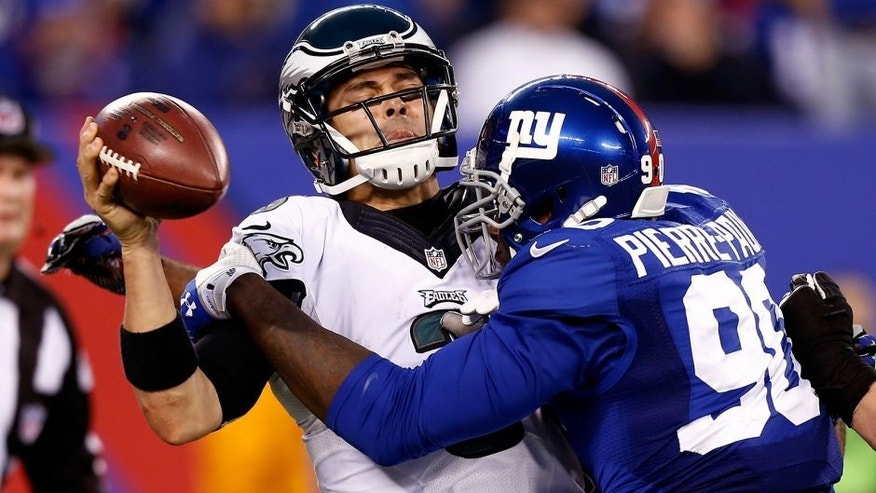 EAST RUTHERFORD, NJ - DECEMBER 28: Jason Pierre-Paul #90 of the New York Giants sacks Mark Sanchez #3 of the Philadelphia Eagles during a game at MetLife Stadium on December 28, 2014 in East Rutherford, New Jersey. (Photo by Jeff Zelevansky/Getty Images)