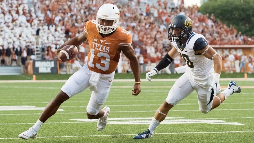 AUSTIN, TX - SEPTEMBER 19: Jerrod Heard #13 of the Texas Longhorns scrambles for a 2 yard touchdown run against the California Golden Bears during the first quarter on September 19, 2015 at Darrell K Royal-Texas Memorial Stadium in Austin, Texas. (Photo by Cooper Neill/Getty Images)