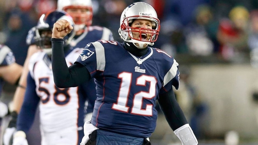 Nov 24, 2013; Foxborough, MA, USA; New England Patriots quarterback Tom Brady (12) reacts after a completed pass against the Denver Broncos during overtime at Gillette Stadium Stadium. Mandatory Credit: Greg M. Cooper-USA TODAY Sports