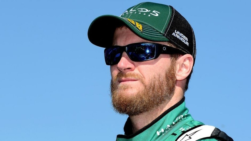 KANSAS CITY, KS - OCTOBER 18: Dale Earnhardt Jr., driver of the #88 Halo 5: Master Chief Chevrolet, stands on the grid prior to the NASCAR Sprint Cup Series Hollywood Casino 400 at Kansas Speedway on October 18, 2015 in Kansas City, Kansas. (Photo by Jeff Curry/Getty Images)