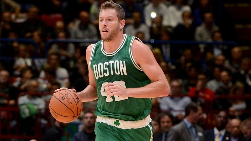 MILAN - OCTOBER 6: David Lee #42 of the Boston Celtics dribbles against Emporio Armani Milano as part of the 2015 Global Games on October 6, 2015 at the Mediolanum Forum, Arena Sala Premium in Milan, Italy. NOTE TO USER: User expressly acknowledges and agrees that, by downloading and or using this photograph, User is consenting to the terms and conditions of the Getty Images License Agreement. Mandatory Copyright Notice: Copyright 2015 NBAE (Photo by Garrett Ellwood/NBAE via Getty Images)