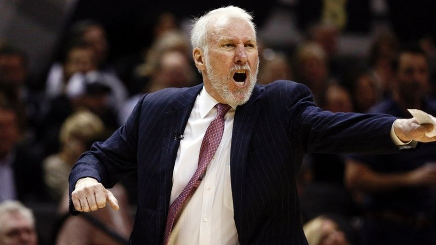 Mar 12, 2015; San Antonio, TX, USA; San Antonio Spurs head coach Gregg Popovich gives direction to his team during the second half against the Cleveland Cavaliers at AT&T Center. Mandatory Credit: Soobum Im-USA TODAY Sports
