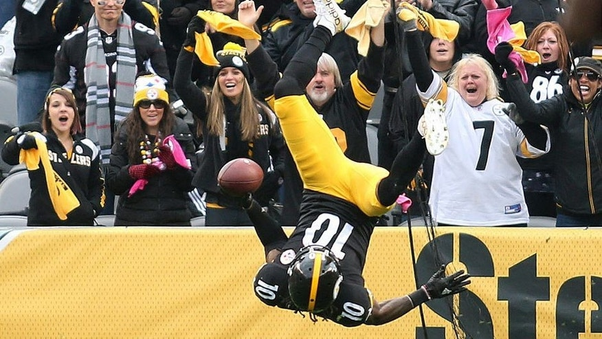 Oct 18, 2015; Pittsburgh, PA, USA; Pittsburgh Steelers wide receiver Martavis Bryant (10) somersaults into the end-zone to score on an eight-eight yard touchdown catch and run against the Arizona Cardinals during the fourth quarter at Heinz Field. The Steelers won 25-13. Mandatory Credit: Charles LeClaire-USA TODAY Sports