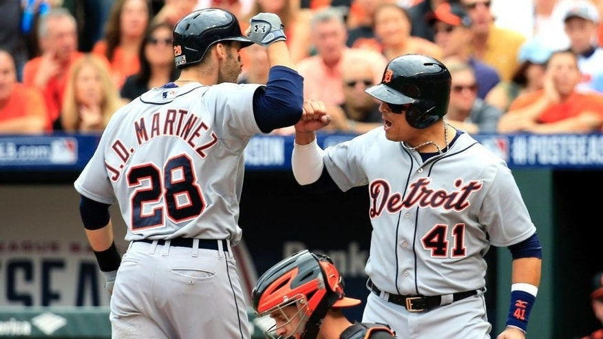 BALTIMORE, MD - OCTOBER 03: J.D. Martinez #28 of the Detroit Tigers celebrates with teammate Victor Martinez #41 after scoring a three run home run in the fourth inning against Wei-Yin Chen #16 of the Baltimore Orioles during Game Two of the American League Division Series at Oriole Park at Camden Yards on October 3, 2014 in Baltimore, Maryland. (Photo by Rob Carr/Getty Images)