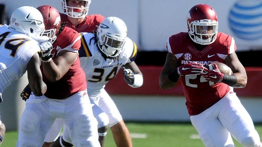Sep 12, 2015; Little Rock, AR, USA; Arkansas Razorbacks running back Kody Walker (24) runs the ball against the Toledo Rockets during the second quarter at War Memorial Stadium. Mandatory Credit: Mark D. Smith-USA TODAY Sports