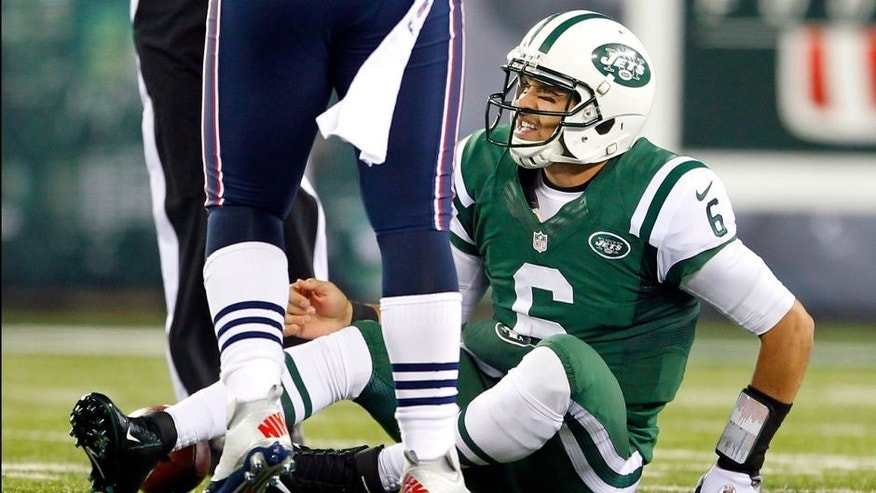 EAST RUTHERFORD, NJ - NOVEMBER 22: Quarterback Mark Sanchez #6 of the New York Jets reacts after getting sacked by the New England Patriots during a game at MetLife Stadium on November 22, 2012 in East Rutherford, New Jersey. (Photo by Rich Schultz /Getty Images)