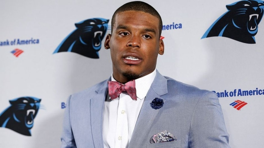 TAMPA, FL - OCTOBER 4: Quarterback Cam Newton #1 of the Carolina Panthers talks with the media after the game against the Tampa Bay Buccaneers at Raymond James Stadium on October 4, 2015 in Tampa, Florida. Panthers defeated the Buccaneers 37 to 23. (Photo by Don Juan Moore/Getty Images)