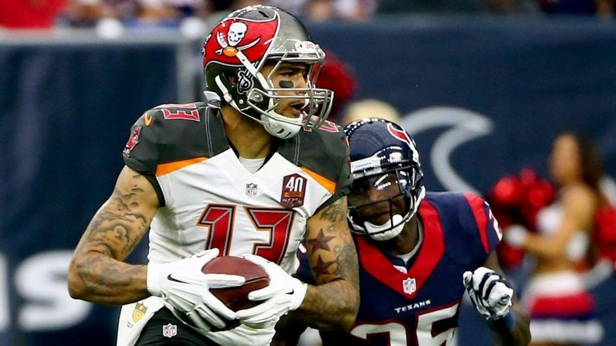 Sep 27, 2015; Houston, TX, USA; Tampa Bay Buccaneers wide receiver Mike Evans (13) runs with the ball as Houston Texans cornerback Kareem Jackson (25) defends during the game at NRG Stadium. Houston won 19-9. Mandatory Credit: Kevin Jairaj-USA TODAY Sports