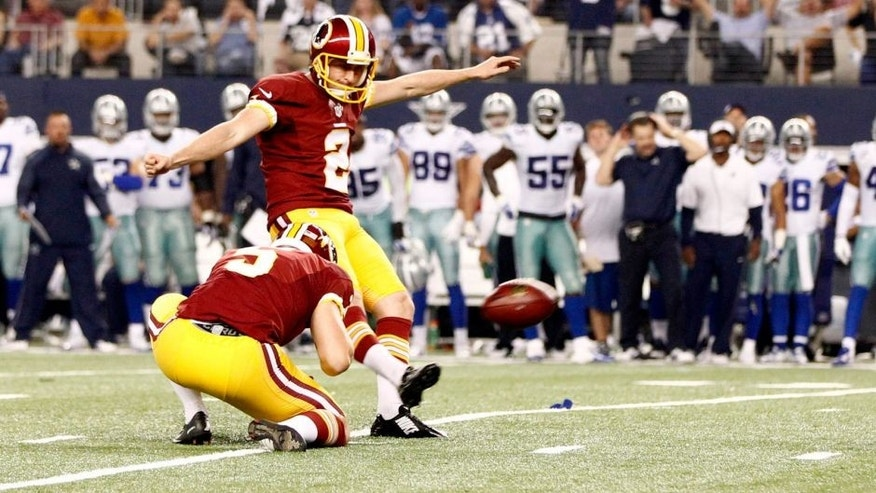 Oct 27, 2014; Arlington, TX, USA; Washington Redskins kicker Kai Forbath (2) kicks a field goal in overtime against the Dallas Cowboys at AT&T Stadium. Washington beat Dallas 20-17 in overtime. Mandatory Credit: Tim Heitman-USA TODAY Sports