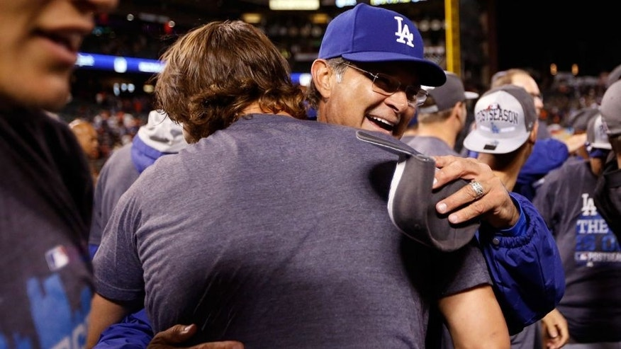 SAN FRANCISCO, CA - SEPTEMBER 29: Manager Don Mattingly hugs Clayton Kershaw #22 of the Los Angeles Dodgers after they beat the San Francisco Giants to clinch the National League West title at AT&T Park on September 29, 2015 in San Francisco, California. (Photo by Ezra Shaw/Getty Images)